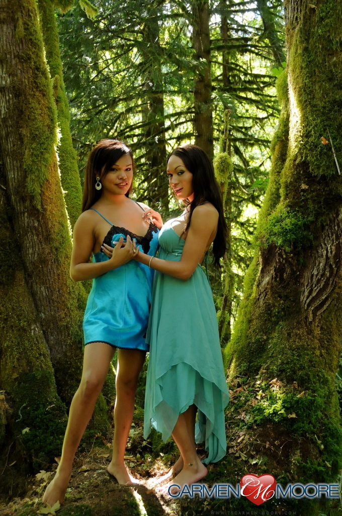 Flirtatious Carmen Posing With Mia On A Mystical Tree