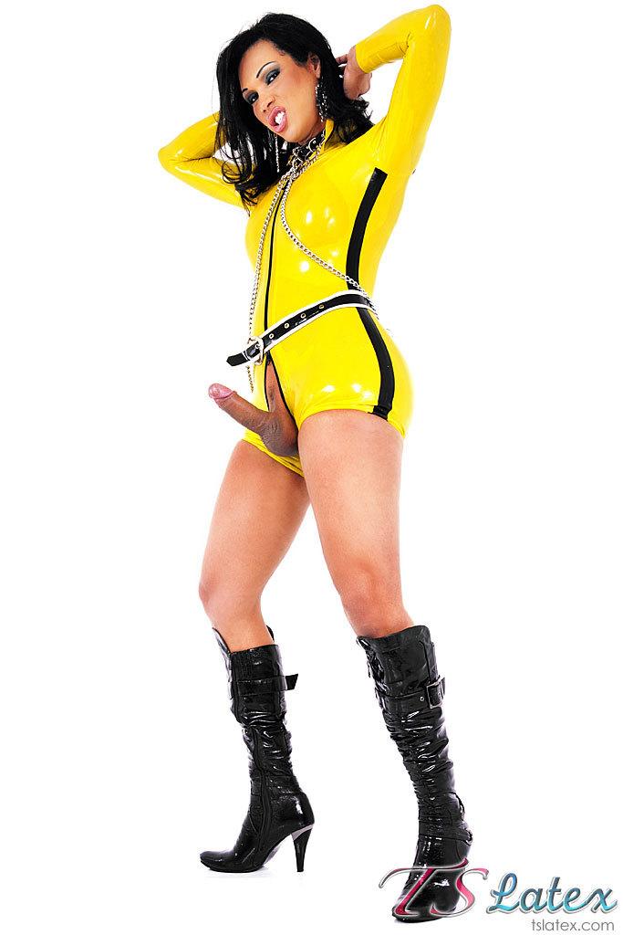 Skimpy Yellow Latex Clad Tgirl Babe
